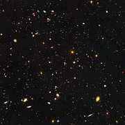 Light-years Prints - Almost Ten Thousand Galaxies As Seen By Hubble Print by Carl Deaville