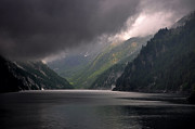 Grey Clouds Prints - Alpine lake with sunlight Print by Mats Silvan