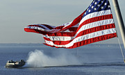 Cushion Posters - American Flag Blowing In The Wind Poster by Stocktrek Images