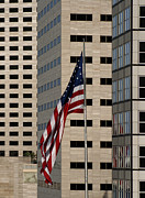 Red Buildings Prints - American Flag in the City Print by Blink Images