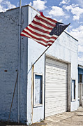 Small Towns Metal Prints - American Flag on an Abandoned Building Metal Print by Paul Edmondson