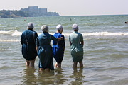 Amish Photographs Posters - Amish Girls in the Surf Poster by MB Matthews