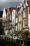 School Houses Framed Prints - Amsterdam Row Houses Framed Print by John Rizzuto