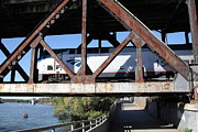 Railroads Framed Prints - Amtrak California Crossing The Old Sacramento Southern Pacific Train Bridge . 5D18571 Framed Print by Wingsdomain Art and Photography