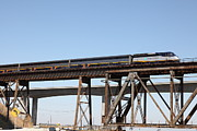 Railroads Photos - Amtrak Train Riding Atop The Benicia-Martinez Train Bridge in California - 5D18839 by Wingsdomain Art and Photography