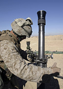 Mortar Posters - An 81mm Mortarman Adjusts The Mortar Poster by Stocktrek Images