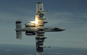 Gunship Prints - An A-10 Warthog Breaks Over The Pacific Print by Stocktrek Images