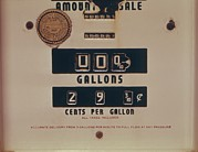 1970s Prints - An Abandoned Gasoline Pump With A Price Print by Everett