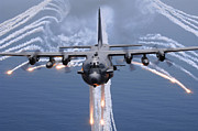 Trails Photo Posters - An Ac-130h Gunship Aircraft Jettisons Poster by Stocktrek Images