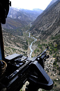 Mountain Valley Framed Prints - An Aerial Gunner Surveys Framed Print by Stocktrek Images