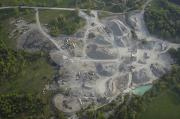 Limestone Quarry Framed Prints - An Aerial View Shows A Limestone Quarry Framed Print by Stephen Alvarez