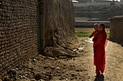 Bonding Metal Prints - An Afghan Girl Carries Her Little Metal Print by Stocktrek Images