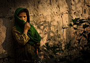 Sheltering Prints - An Afghan Girl Covers Her Face Print by Stocktrek Images