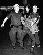 Unrest Photo Framed Prints - An African American Who Police Accused Framed Print by Everett