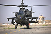 Rotor Blades Photo Prints - An Ah-64 Apache Helicopter Returns Print by Terry Moore
