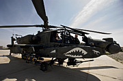 Rotor Blades Photo Prints - An Ah-64d Apache Helicopter Parked Print by Terry Moore