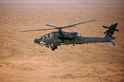 Attack Helicopters Framed Prints - An Ah-64d Apache Longbow Fires A Hydra Framed Print by Terry Moore