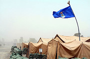 Sandstorm Prints - An Air Force Flag In Tent City Waves Print by Stocktrek Images