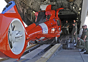 Search And Rescue Photos - An Aircrew Loads A Coast Guard Hh-65 by Stocktrek Images