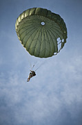 Paratrooper Photo Prints - An Airman Descends Through The Sky Print by Stocktrek Images