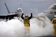 F-18 Prints - An Airman Directs An Fa-18c Hornet Onto Print by Stocktrek Images