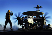 Carrier Framed Prints - An Airman Guides An E-2c Hawkeye Framed Print by Stocktrek Images
