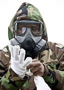 Protective Clothing Prints - An Airman Puts On Protective Chemical Print by Stocktrek Images