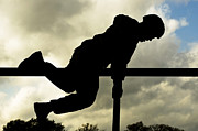 Physical Fitness Framed Prints - An Airman Scales An Obstacle At Camp Framed Print by Stocktrek Images