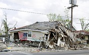 Natural Disaster Photos - An American Flag Is Draped by Everett