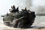 Beachhead Posters - An Amphibious Assault Vehicle Hits Poster by Stocktrek Images