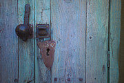 Turquoise And Rust Photos - An antique lock on a by Raul Touzon
