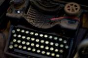 Typewriters Photos - An Antique Typewriter In A Shop by David Evans