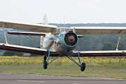 Antonov Framed Prints - An Antonov An-2 Taking Off From An Framed Print by Anton Balakchiev