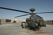 Gunship Prints - An Apache Helicopter At Camp Bastion Print by Andrew Chittock