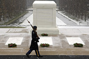 Headstones Prints - An Arlington Honor Guardsman Walks Print by Stocktrek Images