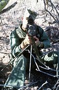 Rangefinder Framed Prints - An Army Ranger Sets Up An Anpaq-1 Laser Framed Print by Stocktrek Images