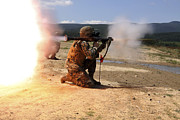 Shoulder-launched Posters - An Assaultman Fires A Rocket Propelled Poster by Stocktrek Images