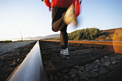 Athletes Posters - An Athlete Runs On Railroad Tracks Poster by Joy Tessman