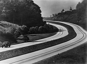 Motor Vehicles Prints - An Automobile On The Sweeping Curves Print by Everett
