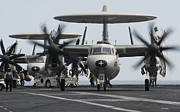 Carrier Posters - An E-2c Hawkeye Aircraft On The Flight Poster by Stocktrek Images