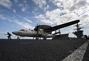 Carrier Posters - An E-2c Hawkeye Aircraft Prepares Poster by Stocktrek Images