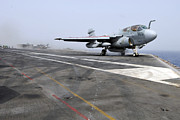 On The Runway Photos - An Ea-6b Prowler Catapults by Stocktrek Images