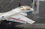 Prowler Photos - An Ea-6b Prowler Is Guided Onto by Giovanni Colla