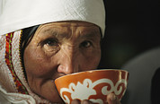 Headgear Prints - An Elderly Woman Drinks From A Cup Print by David Edwards