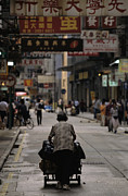 City Streets Posters - An Elderly Woman Pushes A Cart Poster by Justin Guariglia