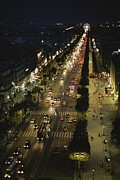 Night Scenes Framed Prints - An Elevated View Of A Traffic-filled Framed Print by Raul Touzon