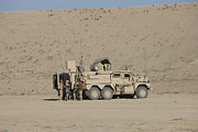 Mrap Photos - An Eod Cougar Mrap In A Wadi by Terry Moore