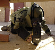 Body Armor Art - An Eod Member Places An X-ray Machine by Stocktrek Images