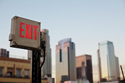 Exit Sign Prints - An Exit Sign In Fron Of A Big City Skyline Print by Frank Rothe