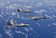 F-15 Prints - An F-15 Eagle And Two F-22 Raptors Fly Print by HIGH-G Productions